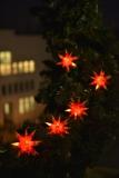 LED STERNE KETTE mit  9 Sternen in rot mit gelben Spitzen
